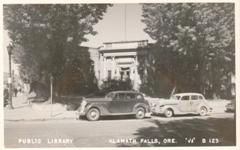 On a corner of Klamath Falls, OR, a Carnegie library stood behind many trees.