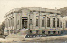 Albert Lea, MN Carnegie library on corner lot, monochrome.