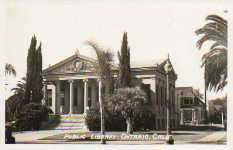 Photo postcard of the nicely landscaped Ontario, CA Carnegie library, since demolished.