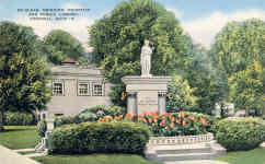 E.C. Kropp postcard of the McClean drinking fountain and the Carnegie library as second billing.