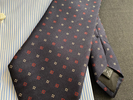 Dark gray birds eye and Blu with red square dots pattern tie.