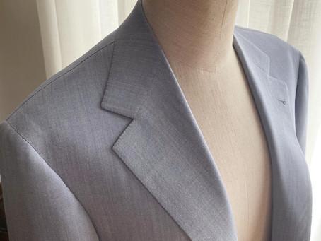 Light blue gray suit.