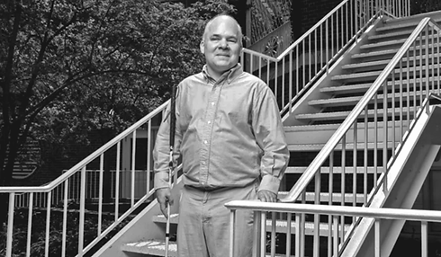 Dr. Weed Standing on Stairs
