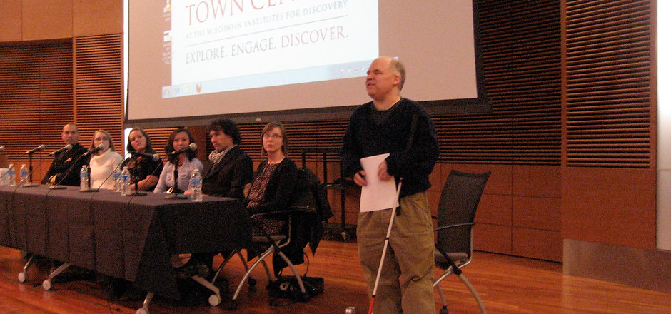Dr. Weed speaks at a panel with six additional participants.