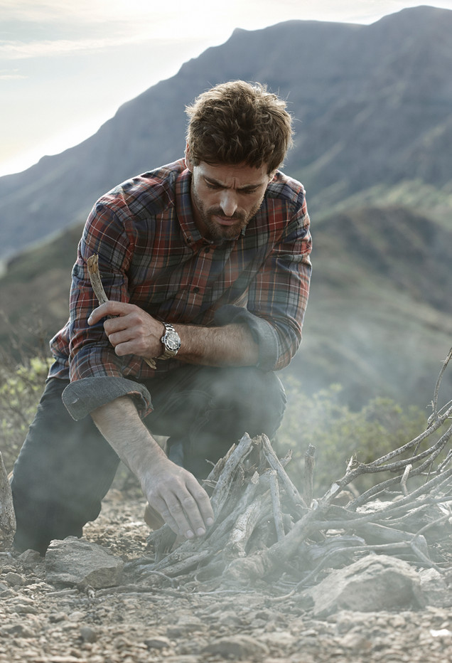 Bison mens fashion, outdoors ison fashion, mountains, lighting a fire, Photographer Christina Bull