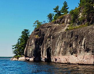 Rounded granite bluff shoreline