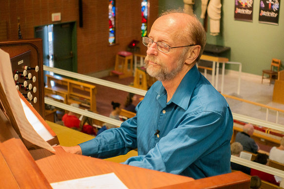 David Lewis at the organ