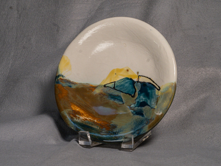 Hand built plate fired to cone 5