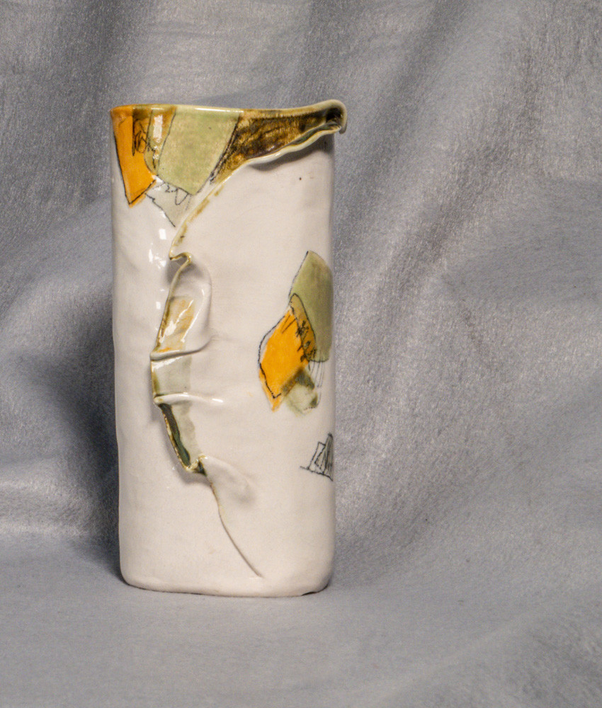 Hand built cylinder with high fire glaze