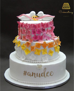 Engagement cake with cute little love bi