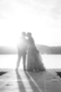 Bride and groom kissing on the dock | Missoula wedding photography