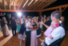 Group of friends taking a selfie at a wedding reception