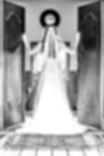 Bride standing with her back to the camera in a doorway