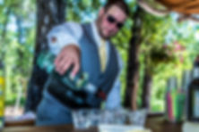 Groomsman pouring drinks at the bar