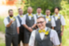 Groomsmen flipping off the groom