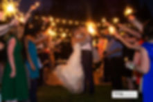 Sparkler send off with bride and groom kissing