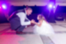 Groomsman dancing with flowergirl