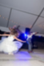 Flowergirl and ring bearer dancing at a reception