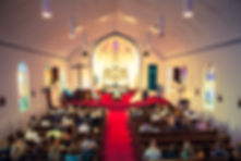 Over head photo of the inside of a Catholic church during a wedding ceremony
