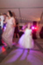 Flowergirl dancing at the reception
