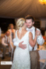 Bride and groom slow dancing at their wedding reception