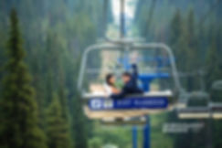 bride and groom on a chairlift