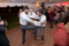 Groomsmen dancing together