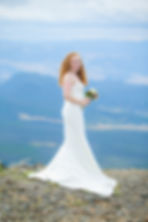 Bride standing at the top of a 10,000 foot mountain