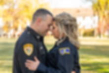 Bride and groom wearing their law enforcement uniforms