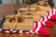 Groomsmen's american flag socks and gifts displayed in a row