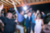 Groom dancing with friends during his wedding reception