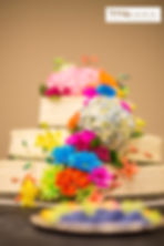 Really colorful and bright wedding cake display