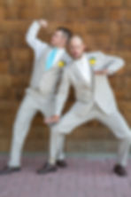 Groom striking a pose with his brother