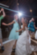 Bride and a bridesmaid dancing during the reception
