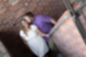 Man kissing his fiance in a stairwell