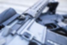 Wedding rings displayed on groom's AR-15 rifle