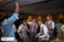Groomsmen cutting a rug