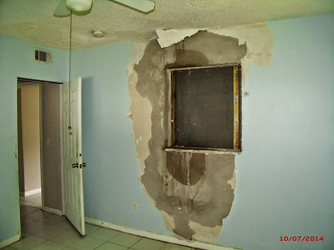 """""""Before"""" photo of interior showing the awful conditions of the house"""