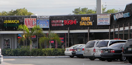 """""""Before"""" photo of the corner of the shopping center before remodeling"""
