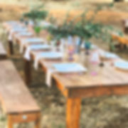 Farm Table and Benches all places set with rustic table settings.