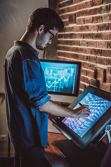 Image of a man working at a screen