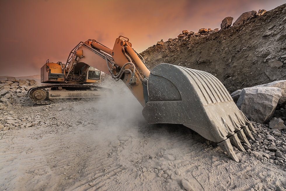 Large excavator extracting stone in a du