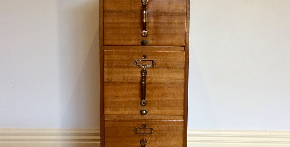 Front Antique Oak Three Drawer Filing Cabinet with Copper Hardware.