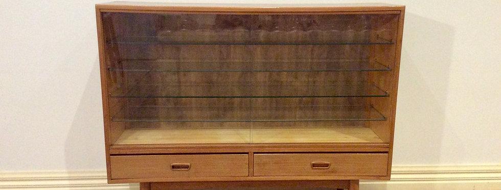 Mid Century Teak Display Cabinet with Cigar Shaped Legs.