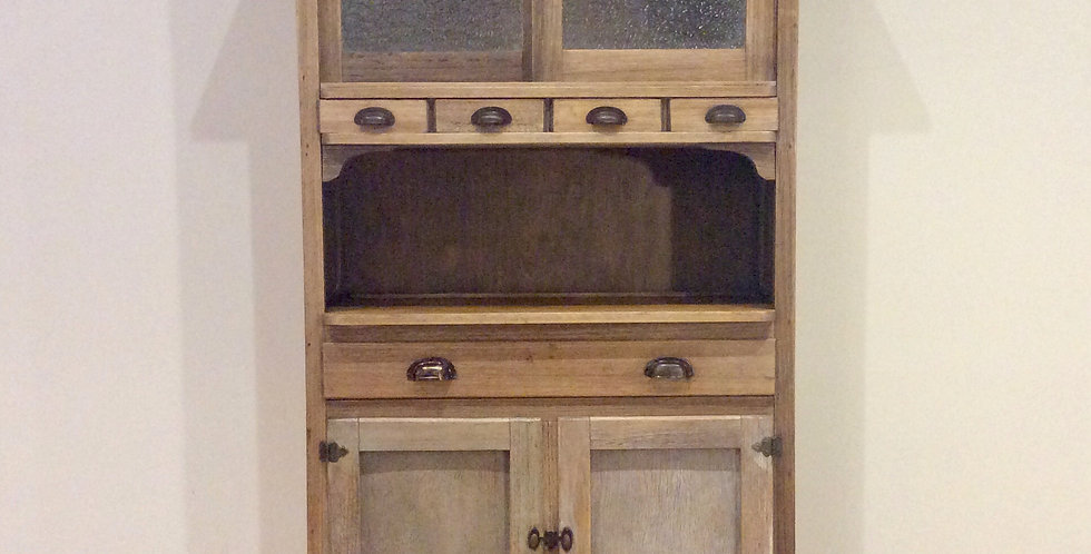 Antique White Oak Five Drawer Kitchen Pantry with Glass Panel Doors.