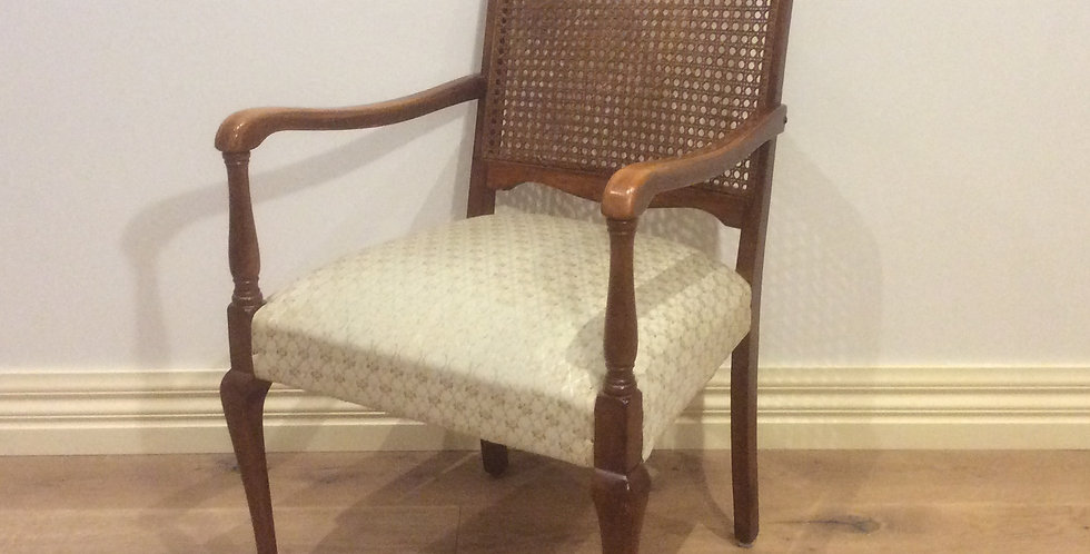 Carved Antique Armchair with Rattan Back.