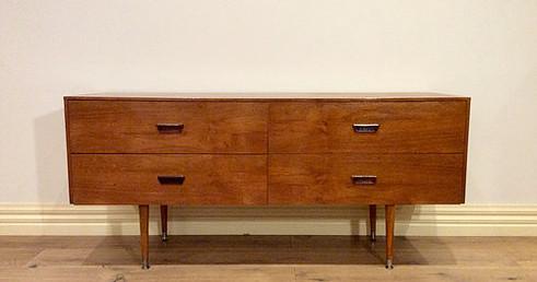 Mid Century Danish Four Drawer Walnut Sideboard with Atomic Legs. Circa 1960.