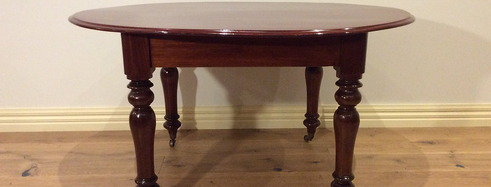 Oval Victorian Cedar Dining Table with Turned Legs & Rolling Castors. Circa 1890.