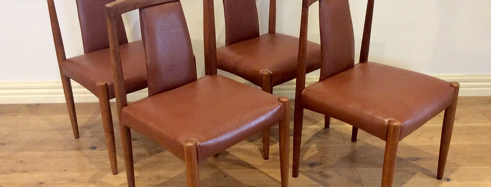 Four Mid Century Parker Dining Chairs with Atomic Style Legs. Circa 1960.