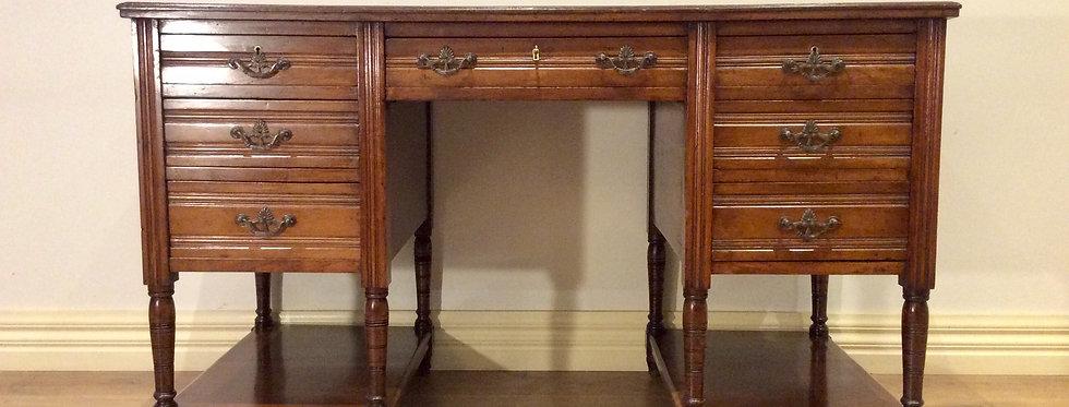 Edwardian Walnut Pedestal Seven Drawer Desk with Tooled Leather Inset.